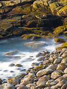 View of wave on rocks, Acadia National Park, near Bar Harbor, Maine, USA.