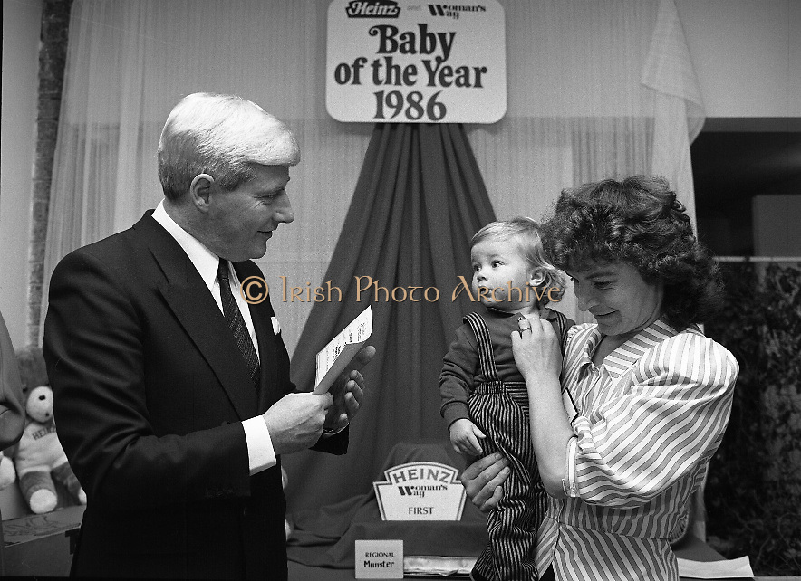 Heinz / Woman's Way, Baby of the Year..1986..21.11.1986..11.21.1986..21st November 1986..The 19th Annual 'Baby of the Year' awards ceremony took place at the Zoological Gardens,Dublin..Baby, Alan Smith from Co Meath was the overall winner.Amy Dempsey from Dublin and Brendan Gallagher from Waterford were placed 2nd and 3rd...Image of third placed Brendan Gallagher with his mother Nell from Waterford accepting their award from Mr John Paul O'Reilly of 'Heinz'.
