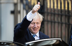 © Licensed to London News Pictures. 23/07/2019. London, UK. Newly elected Conservative Party leader Boris Johnson gives a thumbs up as he leaves party headquarters after attending a reception. Photo credit: Peter Macdiarmid/LNP