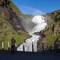 Tourists photographing Kjosfossen