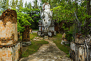 16 JULY 2014 - SAMUT PRAKAN, SAMUT PRAKAN, THAILAND: A statue of an Ayuthaya period Buddha at Ancient Siam. Ancient Siam is a historic park about 200 acres (81 hectares) in size in the city of Samut Prakan, province of Samut Prakan, about 90 minutes from Bangkok. It features historic recreations of important Thai landmarks and is shaped roughly like the country of Thailand.      PHOTO BY JACK KURTZ