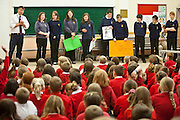 STEM club members make a presentation at the Okehampton Primary School assemby – one of the 11 feeder Primary schools the College has worked with to introduce sustainable energy. The school has just had PV solar panels installed and the theme will be 'not to waste the energy they are now making for themselves'.Okenhampton College, Devon.