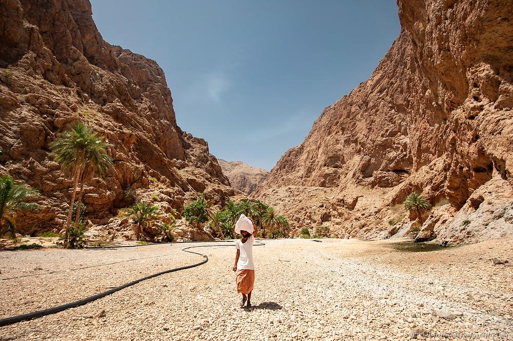 A worker in Wadi Shab, Oman 2011