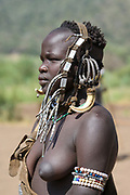 Mursi tribe woman with adornments and tribal make up, Omo valley, Ethiopia