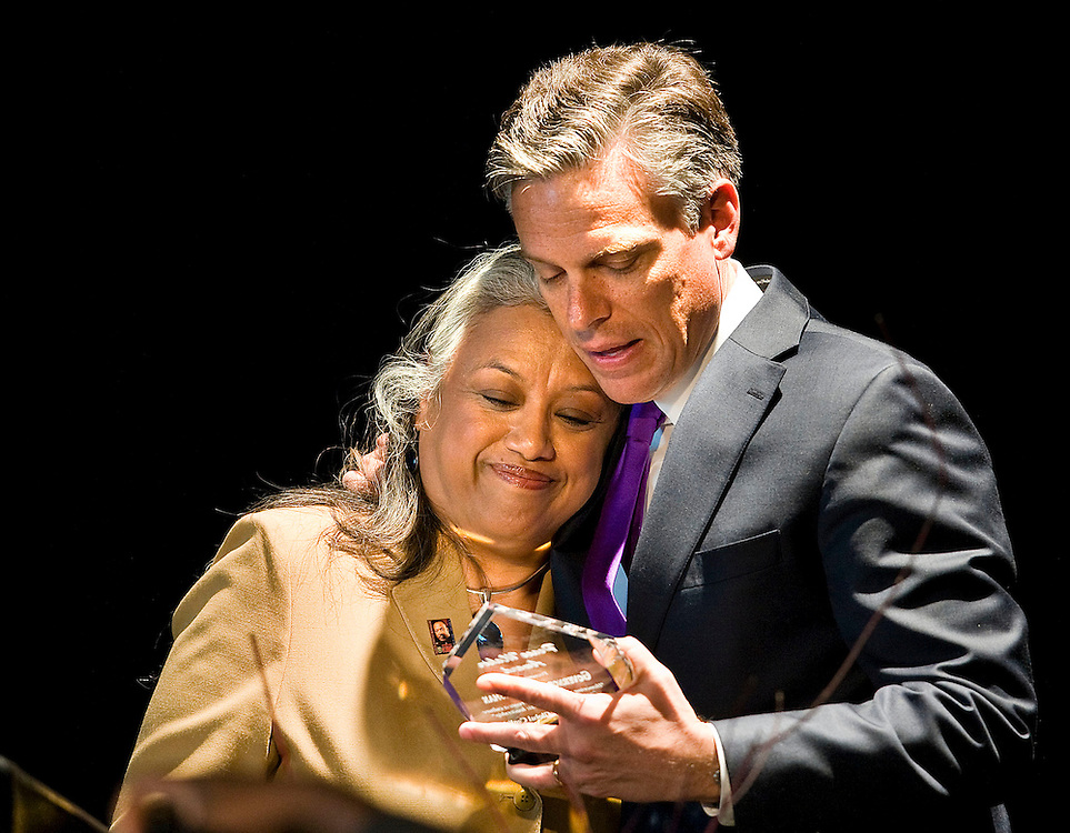 Gov. Jon M. Huntsman Jr. gets a hug from Juanita Ramos Corum after she presented him with an award from the Honor Peace Day Coalition at the MLK celebration luncheon held at the Cultural Celebration Center in West Valley City. Students from Jackson Elementary Violin group also performed and the Keynote speaker was The Most Reverend Bishop John C. Wester of the Catholic Diocese of Salt Lake City. 1/16/09 August MIller/ Deseret News .