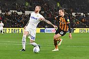 Leeds United defender Pontus Jansson (18) and Hull City midfielder Jackson Irvine (16) during the EFL Sky Bet Championship match between Hull City and Leeds United at the KCOM Stadium, Kingston upon Hull, England on 2 October 2018.Photo. Ian Lyall
