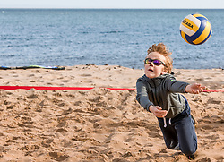 Today marks one year to go before the next Commonwealth Games get underway in Gold Coast, Australia. Athletes from a number of sports joined Scottish Beach Volleyball players, including top duo Lynne Beattie and Mel Coutts, on the new permanent courts on Portobello Beach this morning. The athletes joined with children from Towerbank Primary School to try out the game in the Portobello sunshine.<br /> <br /> <br /> © Jon Davey/ EEm