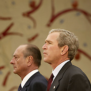 President Bush and French President Jacques Chirac pause during a service for US soldiers killed in the June 6, 1944, D-Day Invasion of Normandy Monday, May 27, 2002, in Colleville, France.  President Bush came to the cemetary to commemorate the Memorial Day Holiday...Photo by Khue Bui