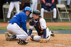 Virginia Cavaliers catcher Beau Seabury (16) tags out Duke Blue Devils 3B Brett Bartles (12) on a play at home.  The Virginia Cavaliers Baseball team fell to the Duke Blue Devils 13-9 in the second of a three game series at Davenport Field in Charlottesville, VA on April 7, 2007.