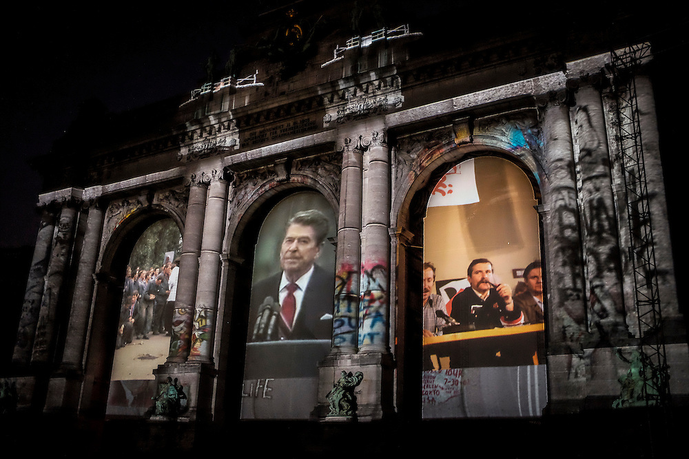 Historical pictures seen during Sounds and Lights of Unity show at the Triuphal Arch in Brussels, Belgium on 01.10.2015 The Triumphal Arch is treated with a sound, light and video show at the day of the celebrating the 25th anniversary of the German reunification   by Wiktor Dabkowski