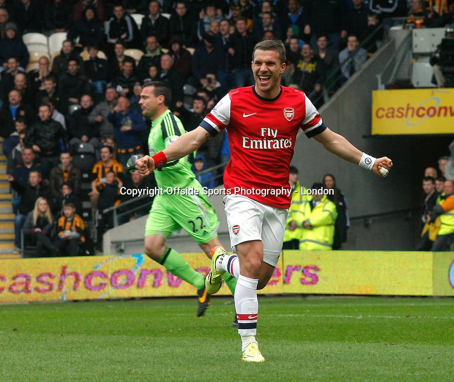 20 April 2014 Premier League Football Hull City v Arsenal -<br /> Lukas Podolski celebrates after scoring the second goal for Arsenal.<br /> Photo: Mark Leech