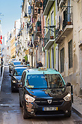 Traditional taxi in steep street, Calcada Santana in Lisbon, Portugal