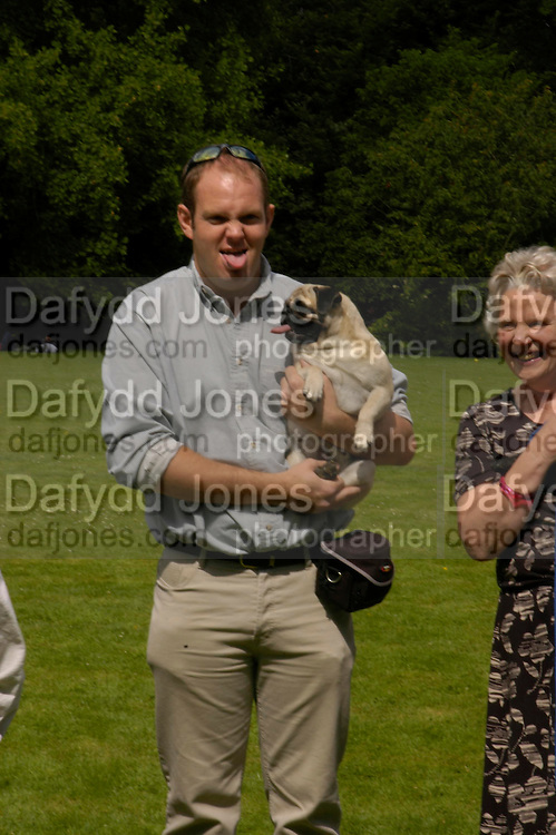 Paul Pleasance with Barbie. Pug Dog club Tea party held at Cottesbrook Hall.  ( home of  Mr. and Mrs. Alastair Macdonald-Buchanan ) 26 June 2005. . ONE TIME USE ONLY - DO NOT ARCHIVE  © Copyright Photograph by Dafydd Jones 66 Stockwell Park Rd. London SW9 0DA Tel 020 7733 0108 www.dafjones.com