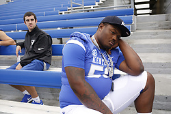 Kentucky defensive tackle Mike Douglas takes a break from the photo sessions during the University of Kentucky's annual media day, Friday, Aug. 07, 2015 at Commonwealth Stadium in Lexington.