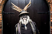 UNITED KINGDOM, Whittlesey: Straw Bear Festival. A senior member of The Witchmen Morris dancers poses for a picture during the Straw Bear festival this weekend. A number of theories for the black face paint exist, from Moorish mimicry to a form of disguise.The three day festival, which originated in 1882, consists of traditional Molly, Morris, Clog and Sword dancing as well as parading a large straw character known as 'The Bear' through the town. Rick Findler  / Story Picture Agency