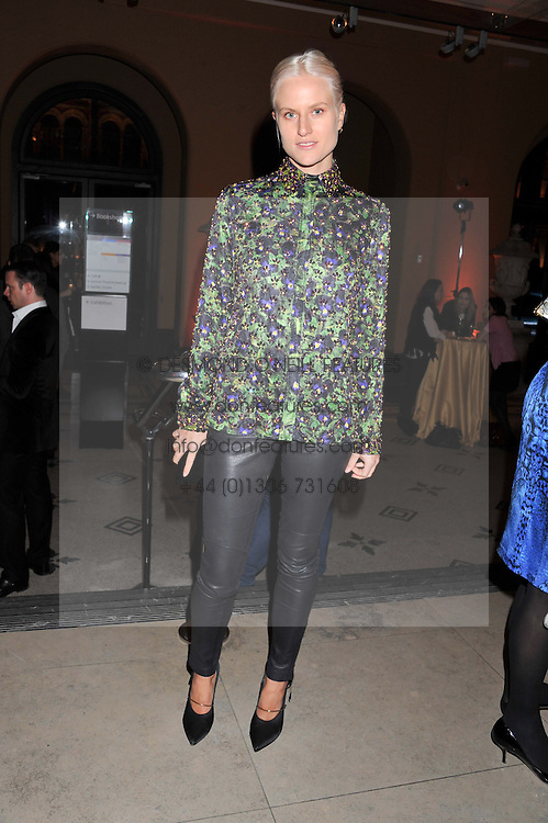 OLYMPIA SCARRY at a private view of the V&A's exhibition Golden Spider Silk held at the Victoria & Albert museum, London on 24t January 2012.