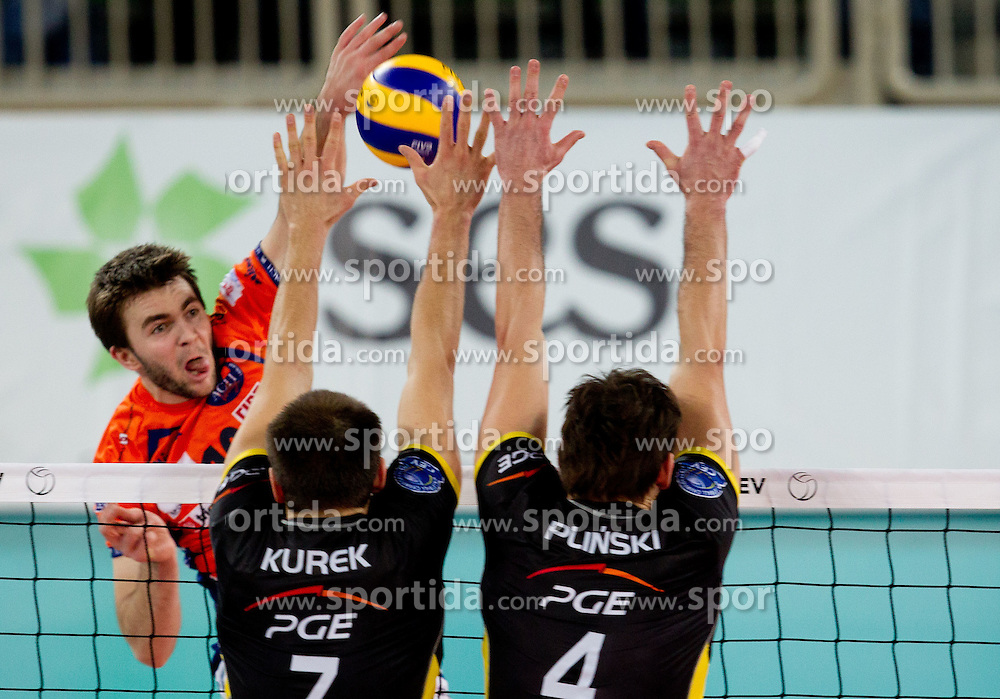 Uros Kovacevic of ACH vs Bartosz Kurek and Wytze Kooistra of Belchatow during volleyball match between ACH Volley LJUBLJANA and  PGE Skra Belchatow (POL) of 2012 CEV Volleyball Champions League, Men, League Round in Pool F, 4th Leg, on December 20, 2011, in Arena Stozice, Ljubljana, Slovenia. Belchatow defeated ACH 3-0. (Photo By Vid Ponikvar / Sportida.com)