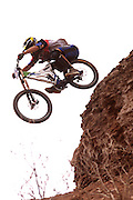 Greg Smith hucks off a cliff at the 2002 Red Bull Rampage freeride mountain bike competition in Virgin, Utah