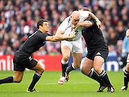 © SPORTZPICS / Seconds Left Images 2010 - England's Mike Tindall tries to hurdle past New Zealand's Daniel Carter (L) and New Zealand's Tony Woodcock  England v New Zealand All Blacks - Investec Challenge Series - 06/11/2010 - Twickenham Stadium  - London - All rights reserved..