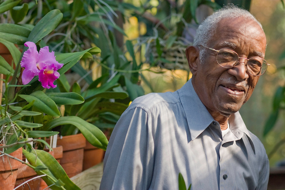 Duke University History Professor Emeritus John Hope Franklin inside his Durham greenhouse filled with a wide variety of exotic orchids, including two strands named after him. Franklin recently won the 2006 John W. Kluge award for his lifetime achievements in the humanities and is author of the seminal book From Slavery to Freedom: A History of African-Americans, now in its seventh edition. Photo by DL Anderson.