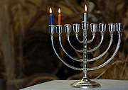 A Chanukia the main symbol of Chanukah, The Jewish festival of light with 3 lit candles for the second day