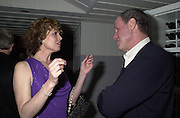 Sigourney Weaver and Michael Eisner. Talk pre-Golden Globes party. Mondrian Hotel.West Hollywood, California USA  20 January 2001. © Copyright Photograph by Dafydd Jones 66 Stockwell Park Rd. London SW9 0DA Tel 020 7733 0108 www.dafjones.com