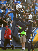 Dec 31, 2017; Carson, CA, USA; Los Angeles Chargers wide receiver Travis Benjamin (12) celebrates with receiver Keenan Allen (13) after scoring on a 62-yard touchdown reception against the Oakland Raiders during an NFL football game at StubHub Center. The Chargers defeated the Raiders 30-10.