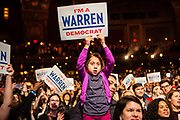 """Brooklyn, NY - 7 January 2020. Massachusetts Senator and Democratic Presidential candidate Elizabeth Warren, joined by former candidate Julián Castro, drew a large and enthusiastic crowd at a speech for her 2020 presidential campaign in Brooklyn's Kings Theatre. A young girl holds a sign reading """"I'm a Warren Democrat."""""""
