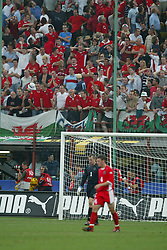 MILAN, ITALY - Saturday, September 6, 2003: Wales' fans dejected after Italy's first goal during the Euro 2004 qualifying match at the San Siro Stadium. (Pic by David Rawcliffe/Propaganda)