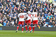 Clayton Donaldson celebrates after scoring Birmingham's equaliser during the Sky Bet Championship match between Brighton and Hove Albion and Birmingham City at the American Express Community Stadium, Brighton and Hove, England on 21 February 2015.