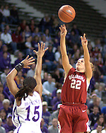 Oklahoma guard Chelsi Welch (22) hits a three pointer over Kansas State's Twiggy McIntyre (15), during the first half at Bramlage Coliseum in Manhattan, Kansas, February 21, 2006.  The 9th ranked Sooners defeated K-State 78-64.
