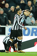 Joselu (#21) of Newcastle United celebrates Newcastle United's first goal (1-1) with Ayoze Perez (#17) of Newcastle United during the Premier League match between Newcastle United and Swansea City at St. James's Park, Newcastle, England on 13 January 2018. Photo by Craig Doyle.