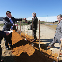 Community Development Foundation President David Rumbarger, center left, directs Gov. Phil Bryant and General Atomics Electromagnetic Systems Group President R. Scott Forney III, to their shovels to break ground for the new expansion at General Atomics in Shannon on Wednesday.