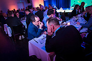 Event Photography images from Tivoli Congress Center in Copenhagen. The client was Basware, based in Finland<br /> <br /> Delegates gather for drinks around the table. <br /> <br /> © Event Photographer in Copenhagen Matthew James