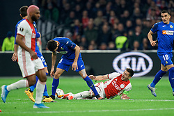 Dusan Tadic #10 of Ajax and Chema Rodriguez #6 of Getafe in action during the Europa League match R32 second leg between Ajax and Getafe at Johan Cruyff Arena on February 27, 2020 in Amsterdam, Netherlands