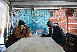 December 13, 2016 - Thessaloniki, Greece - As winter looms migrants from Afghanistan and Pakistan charge their phones at a cafe in Thessaloniki as they wait for the next stages in their migration into Europe. Many of them have made it to more northern borders only to be sent back numerous times. (Credit Image: © ZUMA Wire via ZUMA Wire)