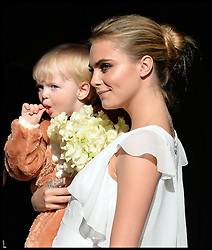 Cara Delevingne arriving at the wedding of Poppy Delevingne to James Cook at St.Paul's Church in Knightsbridge, London,  Friday, 16th May 2014. Picture by Andrew / i-Images