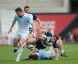 Bristol Rugby Full Back Jack Wallace is tackled by Bedford Blues Scrum-Half Darryl Veenendaal - Photo mandatory by-line: Dougie Allward/JMP - Mobile: 07966 386802 - 29/03/2015 - SPORT - Rugby - Bristol - Ashton Gate - Bristol Rugby v Bedford Blues - Greene King IPA Championship