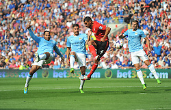 Cardiff City's Steven Caulker attempts to finish a cross but fails forcing a save from Manchester City's Joe Hart- Photo mandatory by-line: Alex James/JMP - Tel: Mobile: 07966 386802 25/08/2013 - SPORT - FOOTBALL - Cardiff City Stadium - Cardiff -  Cardiff City V Manchester City - Barclays Premier League