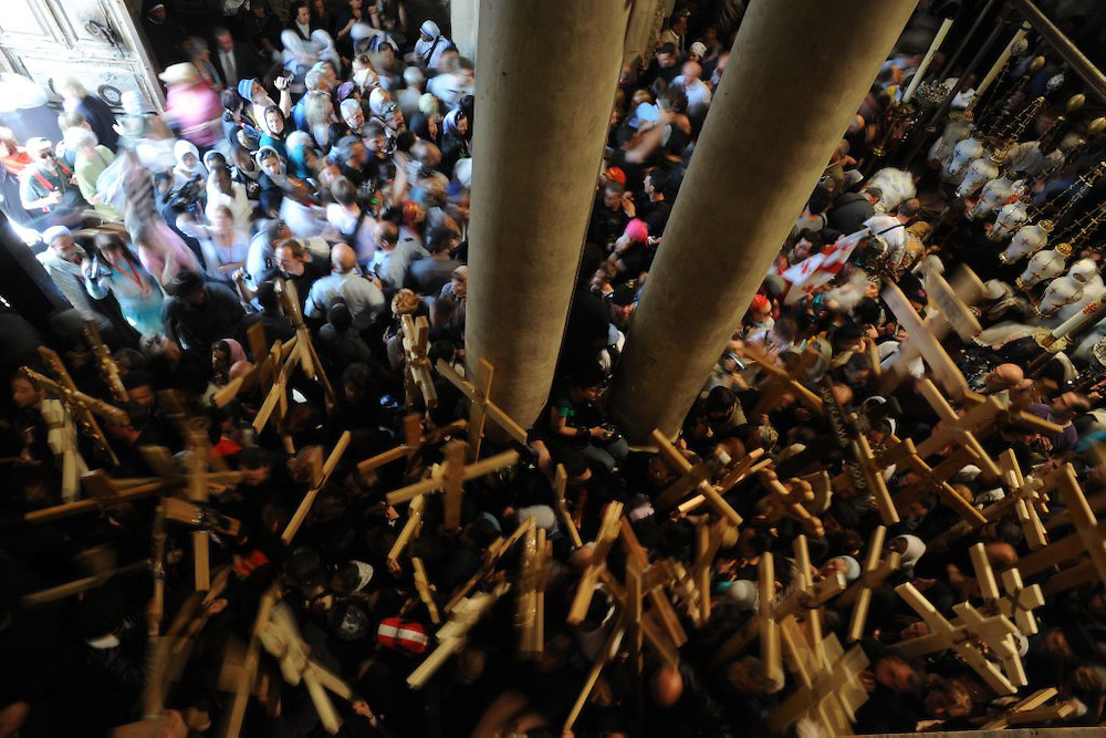 Christian worshippers take part in a Good Friday procession on the Church of the Holy Sepulchre in Jerusalem's Old City on April 2, 2010 Traditionally, it is held to be the path that Jesus walked on the way to his crucifixion. It is marked by nine of the fourteen Stations of the Cross. The last five stations are inside the Church of the Holy Sepulchre. Photo by GILI YAARI
