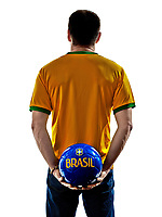 one man with Brazilian jersey holding soccer ball back isolated in white background
