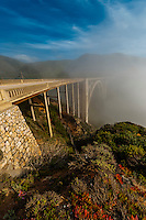 Cars passing over the Bixby Bridge in the fog, Monterey County, California USA