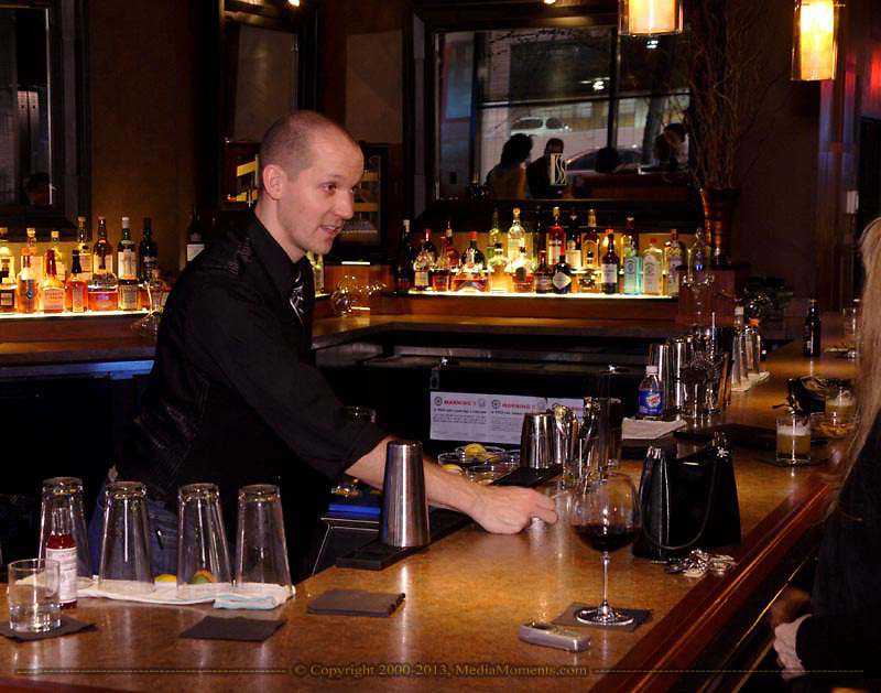 Bartender Garrett Hansbury, from Centerville (left) talks with Chiquita Davis, from Dayton (right) at SideBar lounge, in the First National Plaza in downtown Dayton, Friday, November 7, 2008.