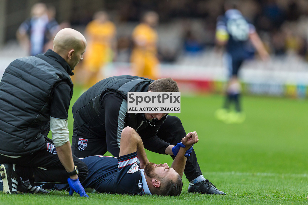 Kenny Van Der Weg gets medical attention during the match between Motherwell and Ross County (c) ROSS EAGLESHAM   Sportpix.co.uk