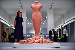 "© Licensed to London News Pictures. 25/06/2019. LONDON, UK. A staff member views ""Medusa"", 2014-2015, by Susie MacMurray from Pangolin London gallery for the Sculpture Series at a preview of Masterpiece London 2019, the world's leading cross-collecting art fair held in the grounds of the Royal Hospital Chelsea.  The fair brings together 157 international exhibitors presenting works from antiquity to the present day and runs 27 June to 3 July 2019.  Photo credit: Stephen Chung/LNP"