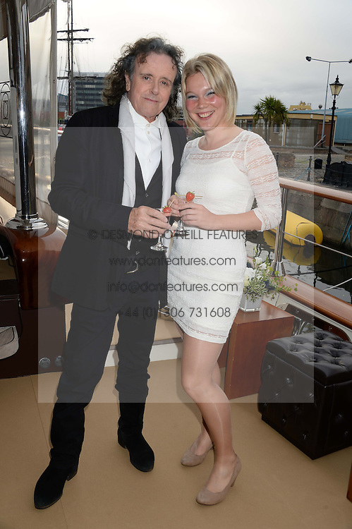 Johnnie Walker Blue Label hosts intimate game changer dinner for 10 Scottish influencers and key arts press aboard the John Walker & Sons Voyager moored at the Prince of Wales Docks, Leith, Edinburgh, Scotland on 14th August 2013.<br /> Picture shows:-Singer Donovan and Joy Hunter.