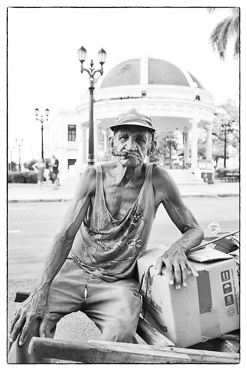 Portrait of an old man in the streets of Cienfuegos, Cuba, with a cigar in the mouth