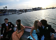 Stephanie Brault and Daniel Thompson, both 17, share a kiss while riding the Balboa Island Ferry with friends Shantal Merchain and Trevor Gurley en-route to dinner before their Corona Del Mar High School Prom Friday May 13, 2005.