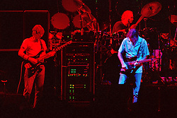 "Phil Lesh, Bob Weir and Bill Kreutzmann performing with The Grateful Dead Live at The Hampton Coliseum on 8 October 1989. One of the ""Formerly The Warlocks"" concerts. Image capture during ""Dark Star"". Limited Edition Photographic Prints available for purchase in Cart."