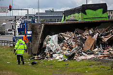 Auckland-Rubbish truck rolls on motorway off ramp